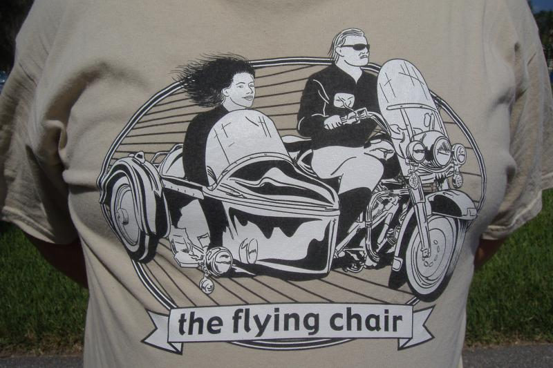 "Tan ""the flying chair"" t-shirt."