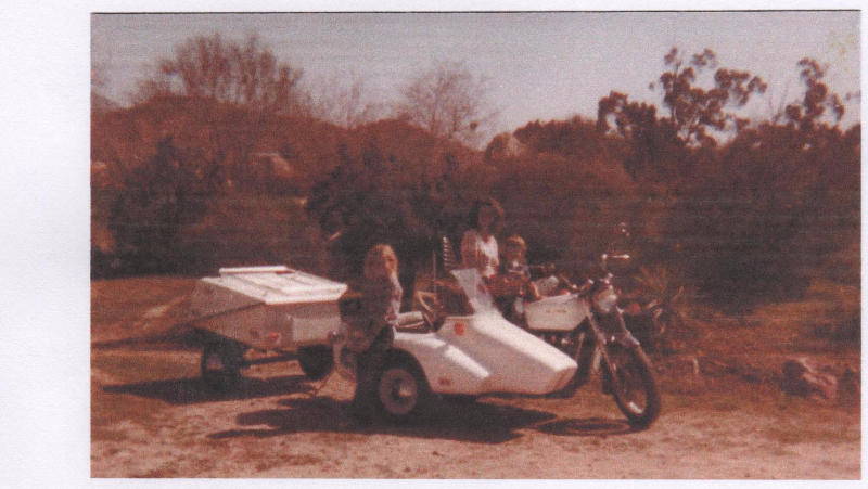 Little girl Kenna and the sidecar named after her going on a camping trip